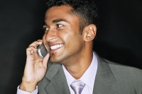 Businessman mobile phone, smiling - Asia Images Group