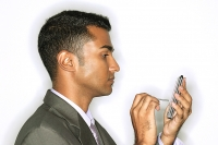 Businessman using PDA, side view - Asia Images Group