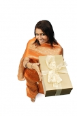 Woman in Indian clothing, holding gift box - Asia Images Group