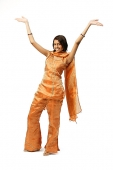 Woman in Indian clothing, arms outstretched - Asia Images Group