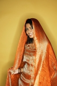 Woman in Indian clothing, scarf draped on head - Asia Images Group