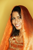 Woman in Indian clothing, smiling, head shot - Asia Images Group