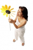 Woman holding pinwheel - Asia Images Group