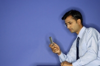 Man using mobile phone - Asia Images Group