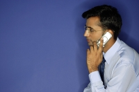 Man using mobile phone, side view - Asia Images Group
