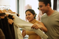 Couple looking at clothes in shop - Asia Images Group