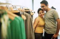 Couple in clothing store - Asia Images Group
