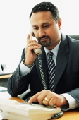 Businessman using telephone - Asia Images Group
