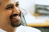 Man using headset, smiling - Asia Images Group