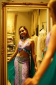 Woman wearing sari, looking at reflection in mirror - Asia Images Group