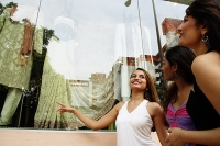 Three women window shopping - Asia Images Group