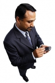 Businessman using PDA - Asia Images Group