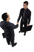Two businessmen shaking hands, high angel view - Asia Images Group