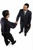 Two businessmen shaking hands - Asia Images Group