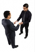 Two businessmen exchanging namecards - Asia Images Group