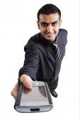 Executive holding PDA towards camera - Asia Images Group