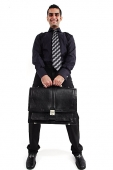Executive carrying briefcase looking at camera - Asia Images Group