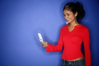 Woman holding mobile phone - Asia Images Group