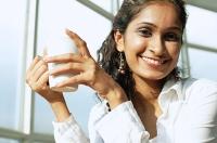 Woman holding mug, smiling at camera - Asia Images Group