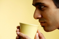 Man holding mug , profile - Asia Images Group