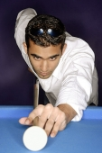 Young man playing pool, portrait - Asia Images Group