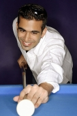 Young man aiming with pool cue - Asia Images Group