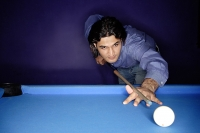 Man playing pool - Asia Images Group
