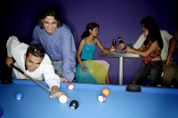 Young adults playing pool and drinking beer - Asia Images Group