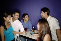 Young adults having drinks in bar - Asia Images Group