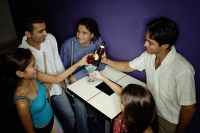Young adults toasting with drinks - Asia Images Group