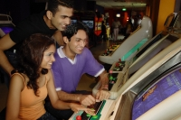 Young adults in video arcade - Asia Images Group