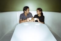 Couple sitting side by side having tea - Asia Images Group