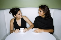 Two women having tea - Asia Images Group