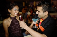 Couple in a club, having drinks - Asia Images Group