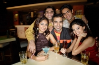 Young adults in club, smiling at camera - Asia Images Group