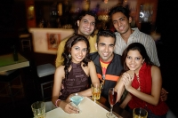 Young adults in club, smiling at camera, portrait - Asia Images Group