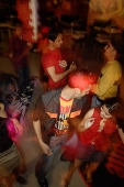 Young adults dancing in night club, high angle view - Asia Images Group