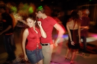 Young adults in night club, dancing - Asia Images Group