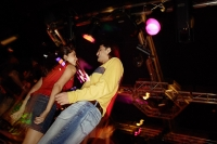 Couple dancing in night club, low angle view - Asia Images Group