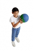 Boy holding basketball, smiling at camera - Asia Images Group