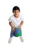 Boy holding basketball, facing forward - Asia Images Group