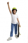 Boy with helmet and skateboard, arm outstretched - Asia Images Group