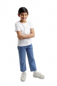 Boy standing looking at camera, arms crossed - Asia Images Group