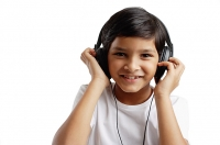 Boy looking at camera, wearing headphones - Asia Images Group