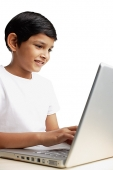 Boy using laptop - Asia Images Group