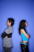Couple standing apart against blue wall - Asia Images Group