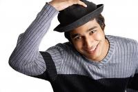 Man wearing hat, smiling at camera - Asia Images Group