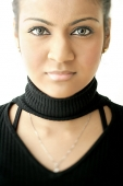 Young woman dressed in black, looking at camera - Asia Images Group