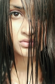 Young woman looking at camera through long wet hair - Asia Images Group