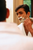 Man shaving his face - Asia Images Group